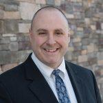 Dr. Corey Olsen – suit and tie