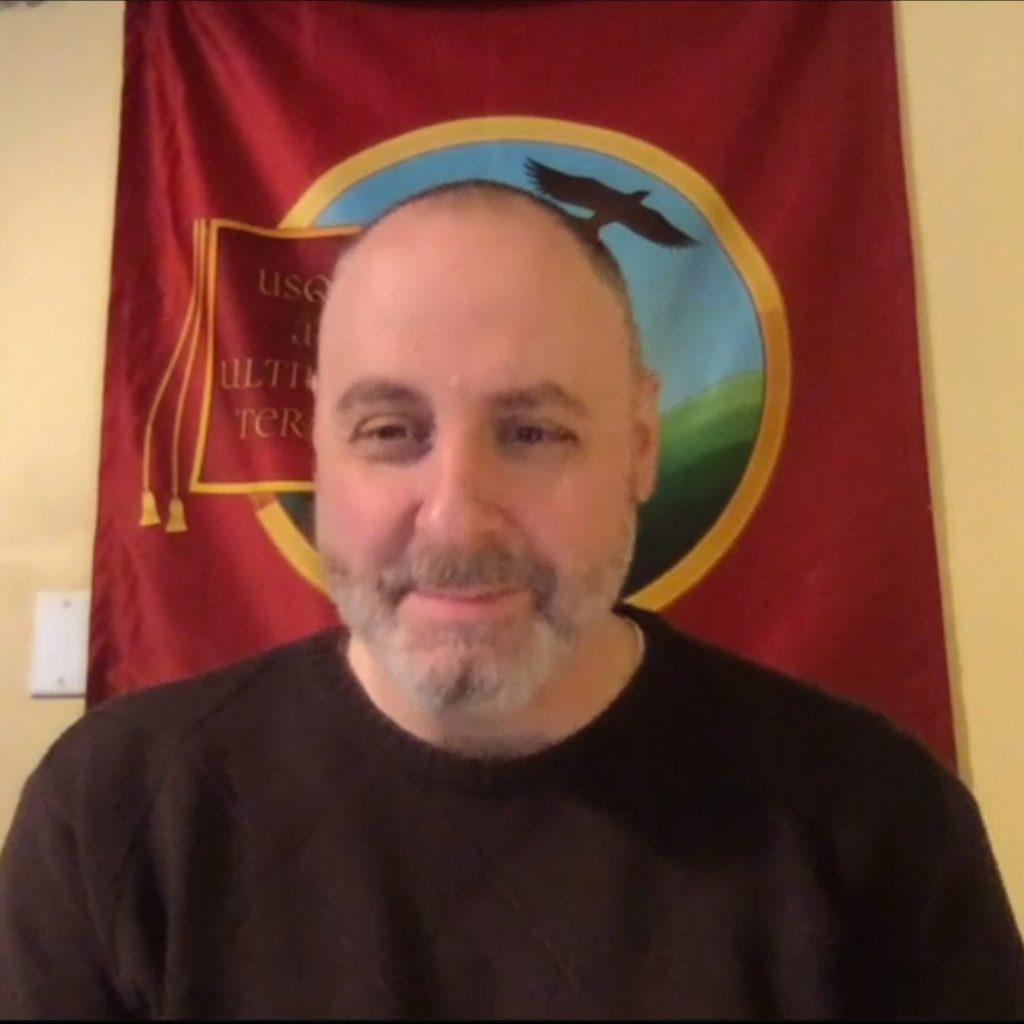 Dr. Corey Olsen teaching online